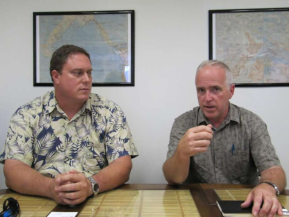 John Van Dame, right, U.S. Pacific Fleet senior environmental planner, and Roy Sokolowski, a U.S. Pacific Fleet sonar modeling expert, speak in Honolulu on Thursday, May 10, 2012 about the Navy's new environmental impact statement for training and testing in Hawaii and California waters. The U.S. Navy says its training and testing using sonar and explosives could potentially hurt more dolphins and whales in Hawaii and California waters than previously thought. (AP Photo/Audrey McAvoy) Photo: Audrey McAvoy, Associated Press
