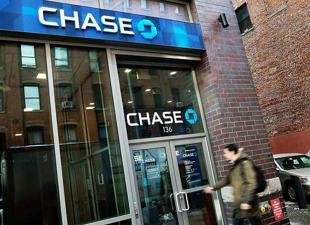 NEW YORK, NY - FILE:  A man enters a JP Morgan Chase branch bank January 14, 2011 in New York City. JPMorgan Chase, one of the nation's largest banks, reported $4.8 billion in income last quarter, a 47 percent jump, sending its stock higher. JPMorgan Chase has said on May 10, 2012 that they have had significant losses, estimated to be at $2 billion, in its synthetic credit portfolio.  (Photo by Chris Hondros/Getty Images) Photo: Chris Hondros, Getty Images