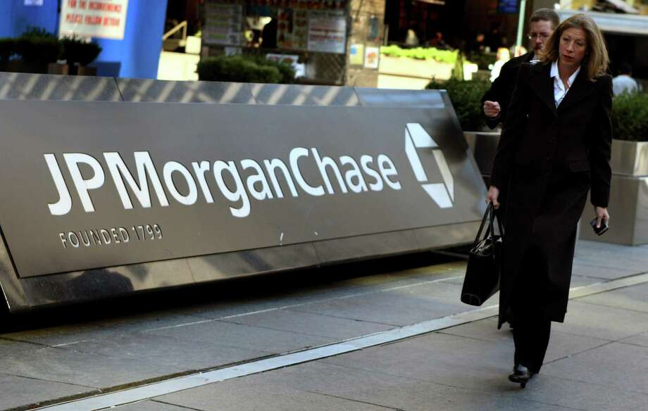 (FILES) In this file picture taken on March 17, 2008 pedestrians walk past the JP Morgan Chase headquarters in New York  JPMorgan Chase plunged nearly 10 percent on opening May 11, 2012after reporting shock $2 billion derivatives losses, pulling down the US markets.The largest US bank's losses, revealed Thursday after the market closed, stunned investors and carried the whole banking sector lower. Fifteen minutes into trade, JPMorgan's shares were down 9.3 percent to $36.95. Hit by collateral damage, Citigroup lost 4.7 percent, Goldman Sachs 4.1 percent and Morgan Stanley 5.5 percent. AFP PHOTO/DON EMMERTDON EMMERT/AFP/GettyImages Photo: DON EMMERT / AFP ImageForum