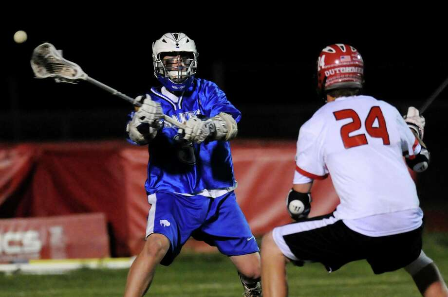 Shaker's Steve Farrell (3), left, passes the ball as Guilderland's Danny Santandrea (24) defends during their lacrosse game on Friday, May 11, 2012, at Guilderland High in Guilderland, N.Y. (Cindy Schultz / Times Union) Photo: Cindy Schultz / 00017651A