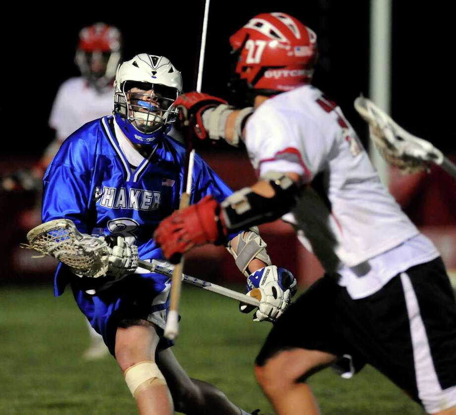 Shaker's Steve Farrell (3), left, defends during their lacrosse game against Guilderland on Friday, May 11, 2012, at Guilderland High in Guilderland, N.Y. (Cindy Schultz / Times Union) Photo: Cindy Schultz / 00017651A