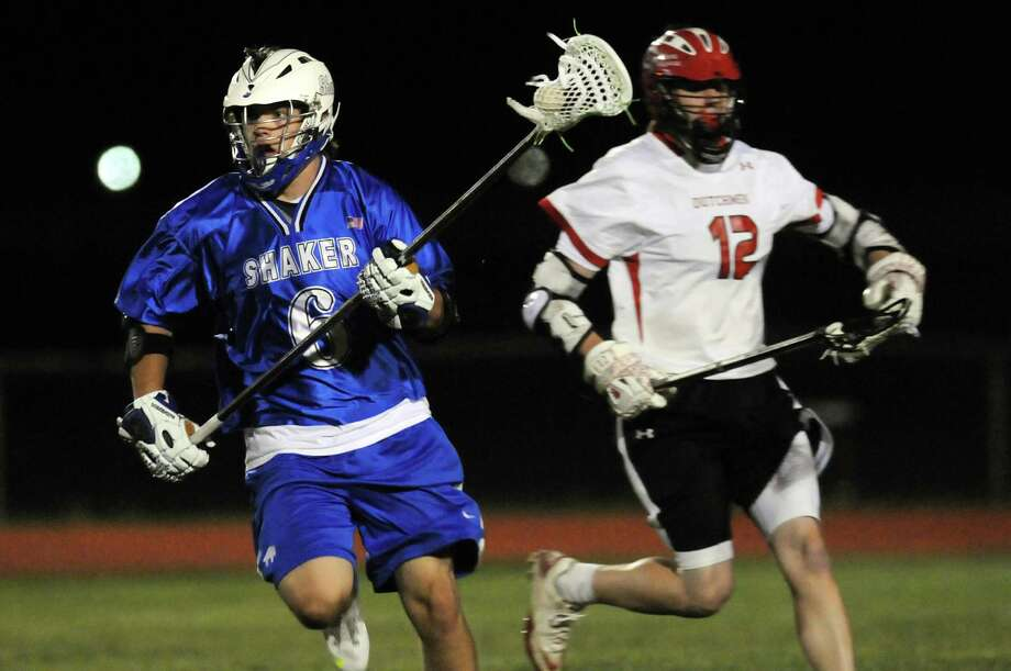 Shaker's Kyle Fragnoli (6), left, carries the ball as Guilderland's Connor McLachlan (12) defends during their lacrosse game on Friday, May 11, 2012, at Guilderland High in Guilderland, N.Y. (Cindy Schultz / Times Union) Photo: Cindy Schultz / 00017651A