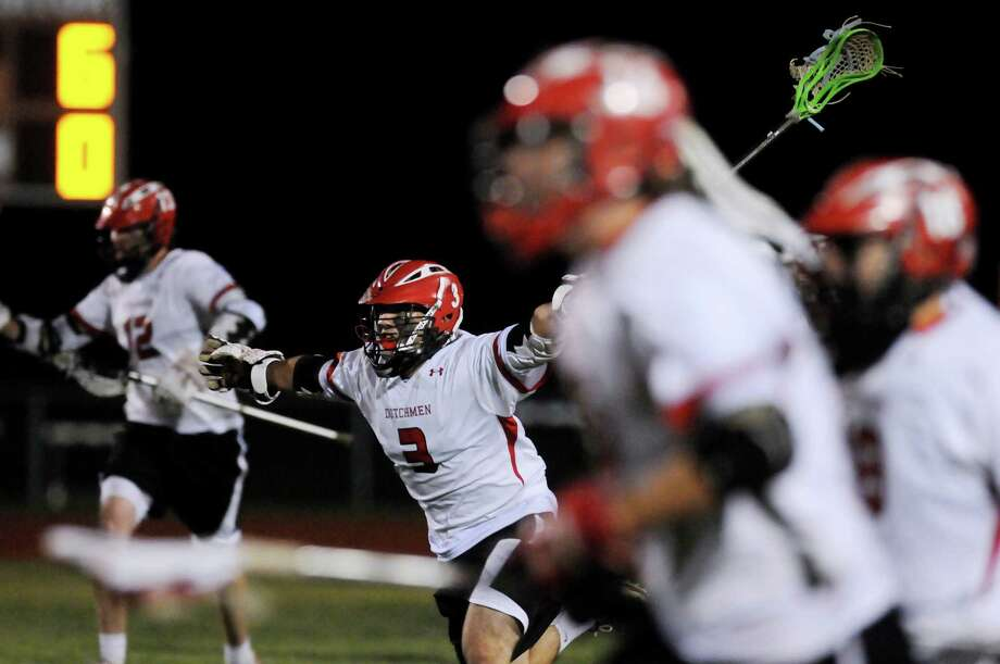 Guilderland's Stephen Polsinelli (3), center, and his teammates celebrate their 9-6 win over Shaker after their lacrosse game on Friday, May 11, 2012, at Guilderland High in Guilderland, N.Y. (Cindy Schultz / Times Union) Photo: Cindy Schultz / 00017651A