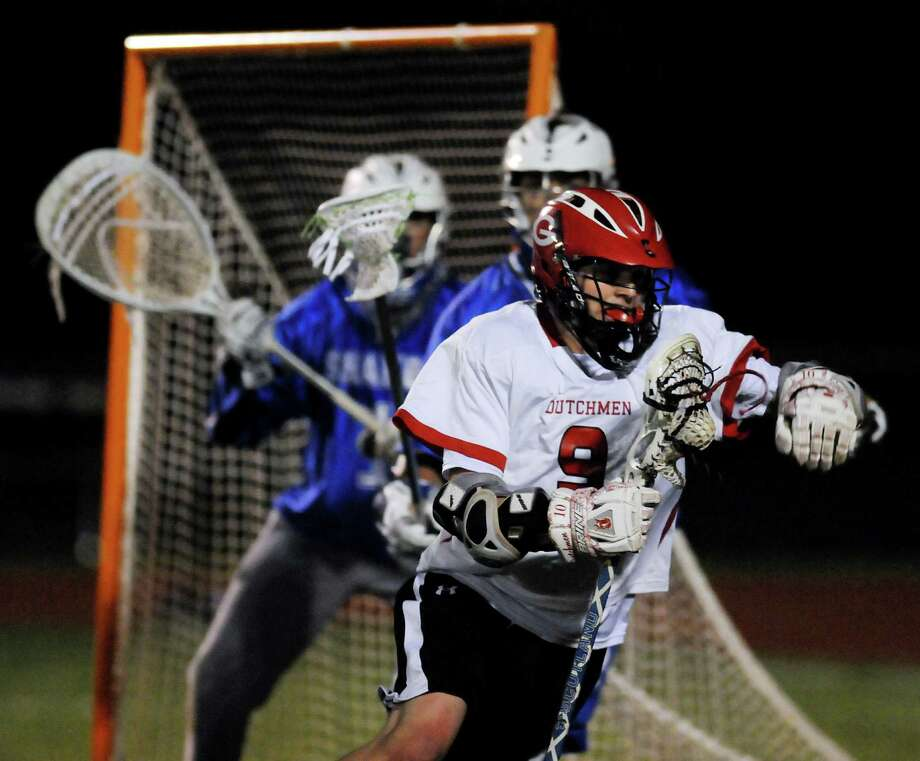 Guilderland's Cody Dyer (9), right, carries the ball during their lacrosse game against Shaker on Friday, May 11, 2012, at Guilderland High in Guilderland, N.Y. (Cindy Schultz / Times Union) Photo: Cindy Schultz / 00017651A