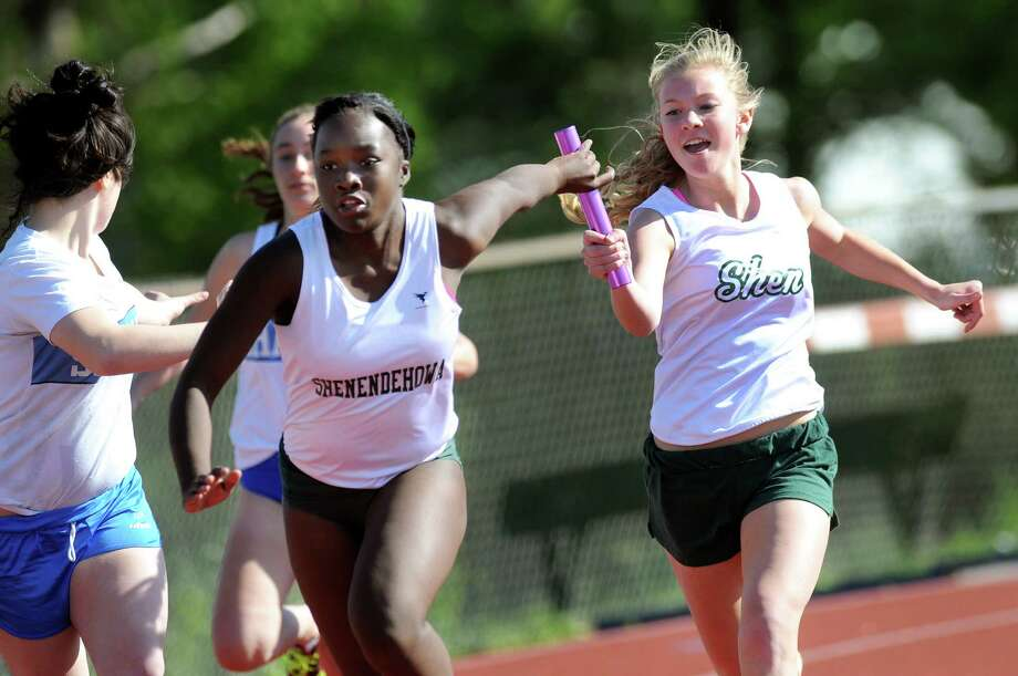 Shenendehowa's Hannah Hathway, right, hands off the baton to Naledi Ushe as they run the 4X1 relay in 57.68 during a track meet on Friday, May 11, 2012, at Shaker High in Latham, N.Y. (Cindy Schultz / Times Union) Photo: Cindy Schultz / 00017649A