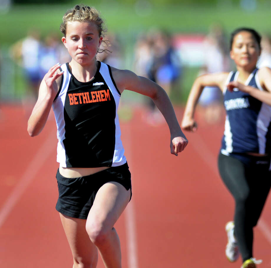 Bethlehem's Lindsay Farbent, left, runs the 100-meter dash in 14.43 during a track meet on Friday, May 11, 2012, at Shaker High in Latham, N.Y. (Cindy Schultz / Times Union) Photo: Cindy Schultz / 00017649A