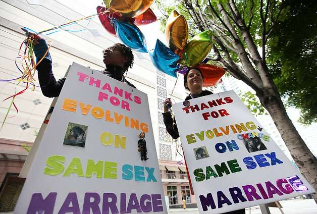 Two women thank President Obama for his support of gay marriage outside a fundraising event in Seattle on Tuesday. Photo: Elaine Thompson, Associated Press