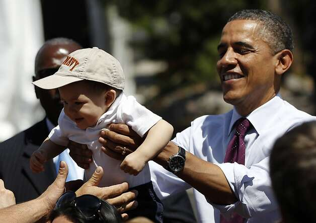 President Barack Obama returns a toddler back to his parents as he greets supporters after speaking about mortgage relief, Friday, May 11, 2012, in Reno, Nev. (AP Photo/Pablo Martinez Monsivais) Photo: Pablo Martinez Monsivais, Associated Press