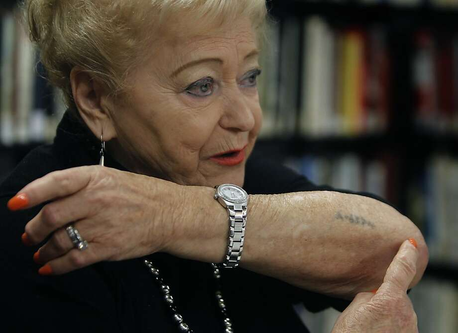 Gloria Lyon displays the tattoo from the Nazis, a permanent reminder of her life in WW II concentration camps, while describing her experience to students in San Francisco, Calif. on Thursday, May 3, 2012. Like many Holocaust survivors, Lyon has endured life-long health problems but after a series of complicated surgeries, she is now able to stand up straight again. Photo: Paul Chinn, The Chronicle