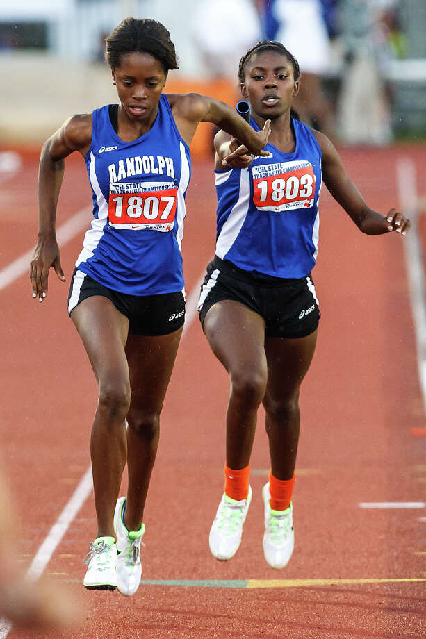 Randolph's Jasmine Waring takes the handoff from Natasha Atkins in the Lady Ro-Hawks winning 2A girls' 800-meter relay during the UIL state track meet at Mike A. Myers Stadium, University of Texas in Austin on May 11, 2012.  Randolph won the event with a time of 1:42.42.  MARVIN PFEIFFER/ mpfeiffer@express-news.net Photo: MARVIN PFEIFFER, Express-News / Express-News 2012