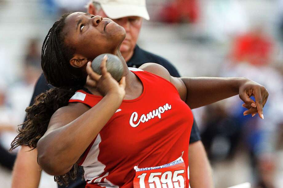 New Braunfels Canyon's Chamaya Turner throws 48-03 to win gold in the 4A girls' shot put during the UIL state track meet at Mike A. Myers Stadium, University of Texas in Austin on May 11, 2012.  Turner also took first place in the discus earlier in the day.  MARVIN PFEIFFER/ mpfeiffer@express-news.net Photo: MARVIN PFEIFFER, Express-News / Express-News 2012