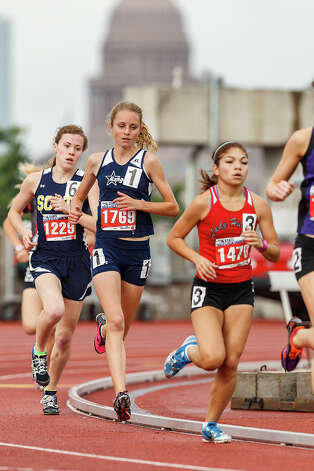 Smithson Valley freshman Devin Clark (center) runs between Highland Park's Natalie Rathjen (left) and LJ Juarez Lincoln's Emilhy Perez in the 4A girls' 3200-meter run during the UIL state track meet at Mike A. Myers Stadium, University of Texas in Austin on May 11, 2012.  Clark finished third with a time of 10:39.13.  The top two finishers, Willis's Cali Roper and Rathjen both broke the state record in the event.  MARVIN PFEIFFER/ mpfeiffer@express-news.net Photo: MARVIN PFEIFFER, Express-News / Express-News 2012