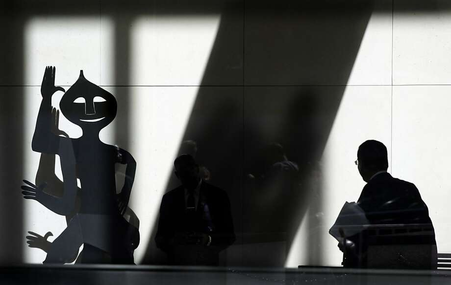 A man passes a sculpture in the lobby of JPMorgan Chase headquarters, Friday, May 11, 2012, in New York. JPMorgan Chase, the largest bank in the United States, said Thursday that it lost $2 billion in the past six weeks in a trading portfolio designed to hedge against risks the company takes with its own money. (AP Photo/Mark Lennihan) Photo: Mark Lennihan, Associated Press