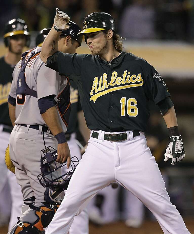 Oakland Athletics' Josh Reddick (16) celebrates after hitting a three run home run off Detroit Tigers' Colin Balester in the seventh inning of a baseball game Friday, May 11, 2012, in Oakland, Calif. (AP Photo/Ben Margot) Photo: Ben Margot, Associated Press