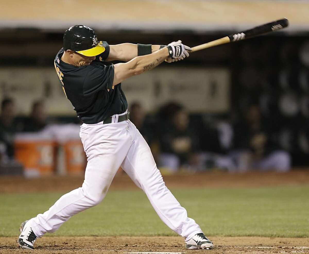 Oakland Athletics' Brandon Inge swings for a three run home run off Detroit Tigers' Duane Below during the sixth inning of a baseball game Friday, May 11, 2012, in Oakland, Calif. (AP Photo/Ben Margot)