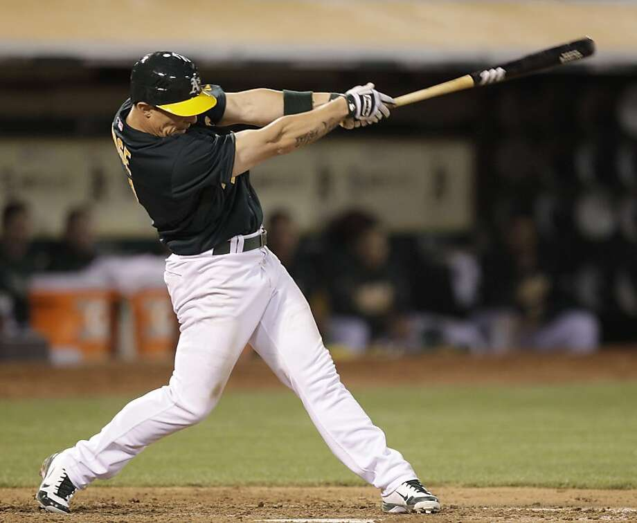 Oakland Athletics' Brandon Inge swings for a three run home run off Detroit Tigers' Duane Below during the sixth inning of a baseball game Friday, May 11, 2012, in Oakland, Calif. (AP Photo/Ben Margot) Photo: Ben Margot, Associated Press