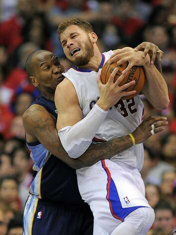 Memphis Grizzlies center Marreese Speights, left, ties up Los Angeles Clippers forward Blake Griffin during the second half in Game 6 in their first-round NBA basketball playoff series, Friday, May 11, 2012, in Los Angeles. The Grizzlies won 90-88. (AP Photo/Mark J. Terrill) Photo: Mark J. Terrill, Associated Press