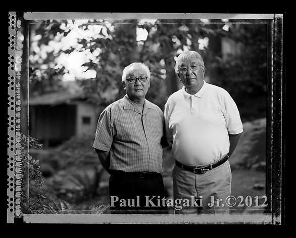 "Bill Asano, 70, right, and his brother, Jerry Aso, 67,  photographed in Portland, Oregon September 1, 2006 are both dental professionals. On May 5, 1942 they were photographed with their 70 year old grandfather Sakutaro Aso, who started the Mt. Eden Laundry in Hayward, California and sold the business before going to the Tanforan Assembly Center, Topaz and Amache Internment Camps during WWII. Bill said,""  when I look at the picture I can see my grandfather realized that something terrible was happening and his life was never going to be the same again, that was the end of the line for him.""  Jerry said looking at the photo graph of his grandfather, "" So his dream of coming to the United States, his dream of making a life, his dream of having his children working in this business, to support them all were totally dashed."" Photo: Paul Kitagaki Jr., Paul Kitagaki Jr. ©2012"