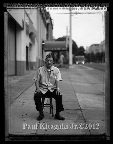 Mitsunobu ÒMitsÓ Kojimoto, 85, sits in outside the building on Van Ness Street in San Francisco July 11, 2008 where he waited for a bus to take him to the SantaAnita Assembly Center. At age 19, Kojimoto volunteered for the U.S. Army and joined the 442nd Regimental Combat Team, H company. He received the Bronze Star for his service in France and Italy. Photo: Paul Kitagaki Jr., Paul Kitagaki Jr. ©2012
