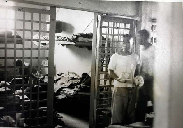 Itaru Ina, right foreground, stands  in the Tule Lake interment camp jail during WWII before he was sent to the Department of Justice Interment camp for enemy aliens in at Fort LIncoln,  Bismarck, North Dakota.  Photograph from the National Archives and Records Administration Photo: National Archives