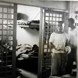 Itaru Ina, right foreground, stands  in the Tule Lake interment camp jail during WWII before he was sent to the Department of Justice Interment camp for enemy aliens in at Fort LIncoln,  Bismarck, North Dakota.  Photograph from the National Archives and Records Administration