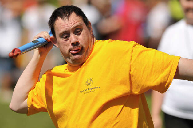 Chad Tihor, of Danbury, representing Ability Beyond Disability, competes in the turbo javeline event during the Special Olympics Connecticut Northwest Regional Games at Danbury High School on Saturday, May 12, 2012. Photo: Jason Rearick / The News-Times