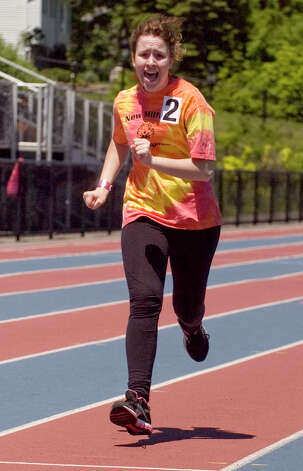 Leila Johnson competes in the 400-meter run during the Special Olympics Connecticut Northwest Regional Games at Danbury High School on Saturday, May 12, 2012. Photo: Jason Rearick / The News-Times