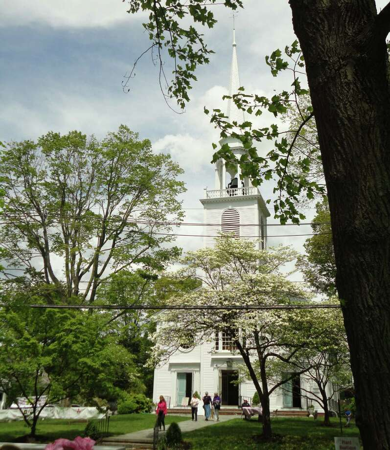 A few of the remaining blossoms on Greenfield Hill dogwood trees frame the historic Greenfield Hill Congregational Church at the start of the 77th Dogwood Festival on Friday. Photo: Meg Barone / Fairfield Citizen freelance