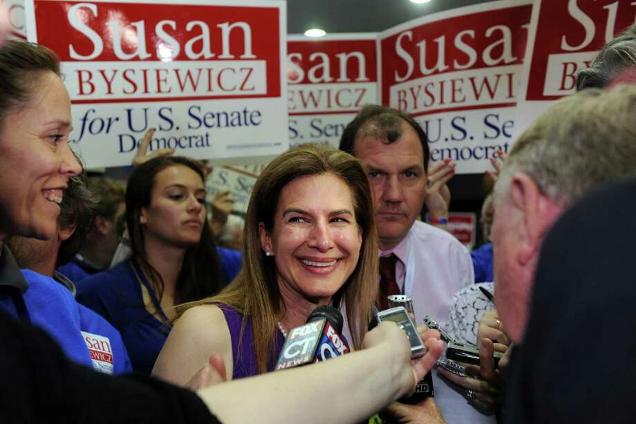 Former Secretary of the State Susan Bysiewicz talks to the media after losing the Democrat's endorsement as candidate for the U.S. Senate during the Democratic State Convention at Central Connecticut State University's Kaiser Hall in New Britain Saturday, May 12, 2012. U.S. Rep Chris Murphy garnered 76 percent of the 1823 delegates to take the party endorsement. Photo: Autumn Driscoll / Connecticut Post