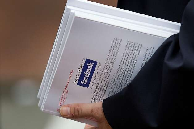 An investor holds a pamphlet during a Facebook Inc. IPO Meeting in Boston, Massachusetts, U.S., on Tuesday, May 8, 2012. Facebook Inc. officials are touting growth prospects for the largest social network in meetings this week in New York and Boston with hundreds of would-be investors before its record initial public offering. Photographer: Scott Eisen/Bloomberg Photo: Scott Eisen, Bloomberg