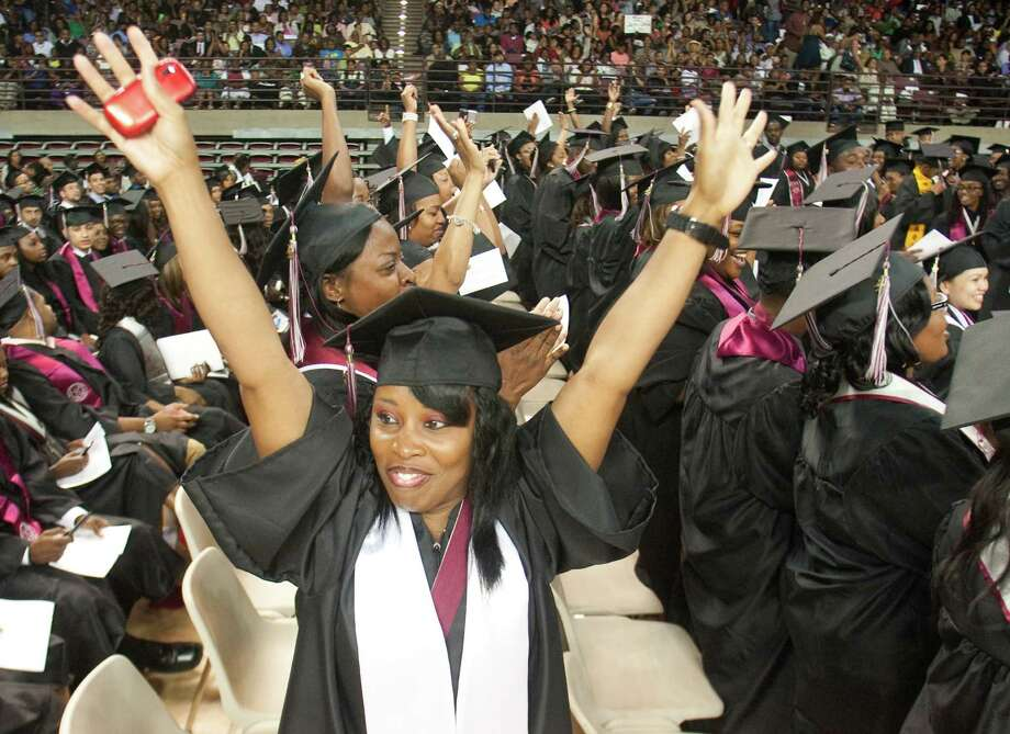 DaRhonda Williams celebrates during graduation ceremonies at Texas Southern University on Saturday, May 12, 2012 in Houston, Texas.  DaRhonda received a Bachelors in Health Administration. Photo: J. Patric Schneider, For The Chronicle / Houston Chronicle