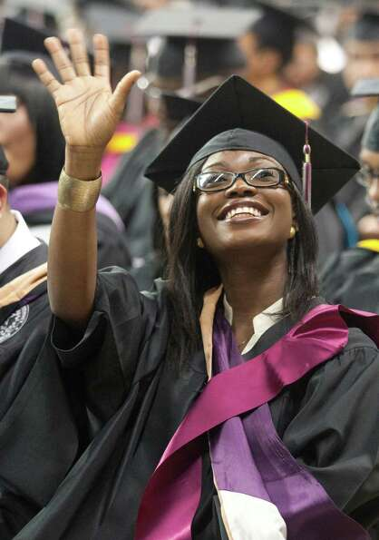Adewunmi Folowosele waves to her parents during graduation ceremonies at Texas Southern University o
