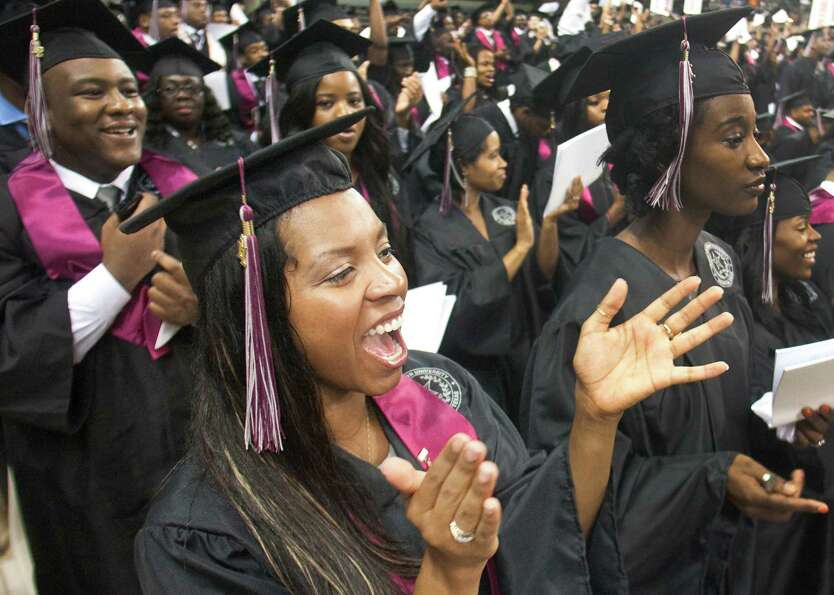 Megan Martinez celebrates during graduation ceremonies at Texas Southern University on Saturday, May