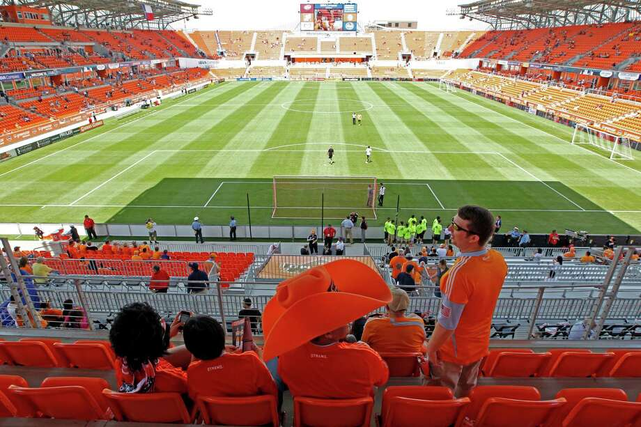 Houston Dynamo fans sit inside BBVA Compass Stadium during the stadium's opening day. Photo: James Nielsen, Chronicle / © Houston Chronicle 2012