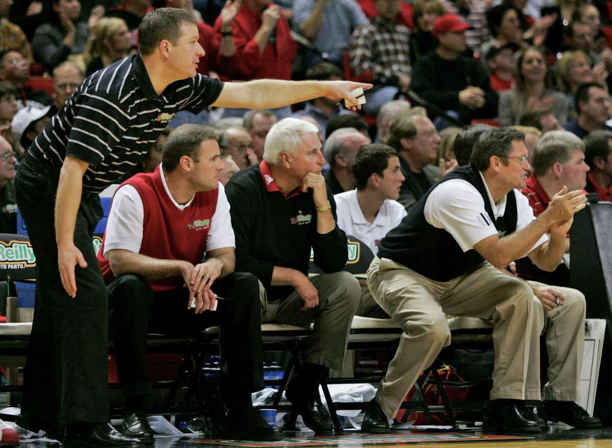From left to right, Texas Tech assistant coach Chris Beard, and Pat Knight, head coach Bob Knight, Bubba Jennings, and Tim Knight keep an eye on their team during the first half of their basketball game with UNLV in Lubbock, Texas, Thursday, Dec. 28, 2006.(AP Photo/Tony Gutierrez)