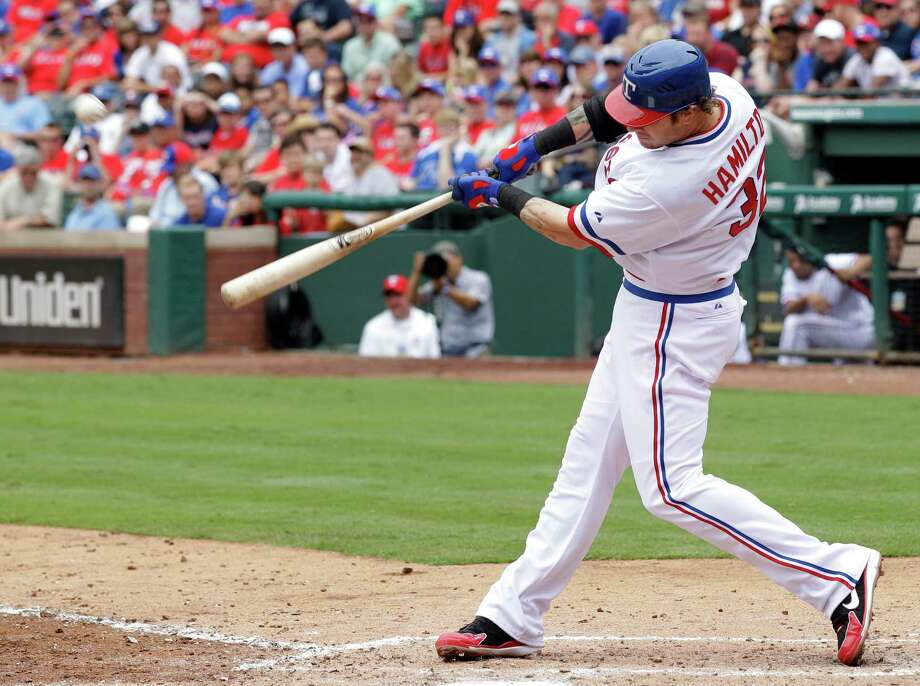 Texas Rangers' Josh Hamilton connects for a solo home run off of Los Angeles Angels starting pitcher C.J. Wilson in the sixth inning of a baseball game Saturday, May 12, 2012, in Arlington, Texas. The shot was Hamilton's 18th of the season in the 4-2 Rangers loss. Photo: AP