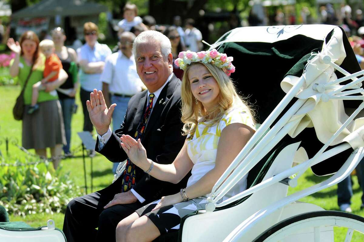 Mayor Jerry Jennings, center, shares a carriage ride with 2011 Tulip Queen Karen Colehour during the procession at the Tulip Festival on Saturday, May 12, 2012, at Washington Park in Albany, N.Y. (Cindy Schultz / Times Union)