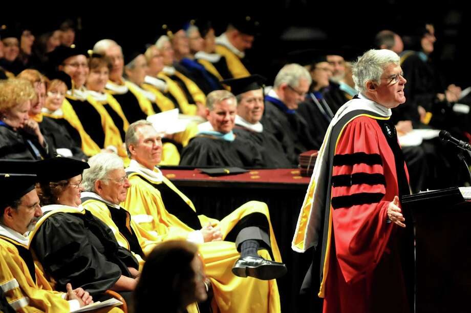 College president Mark Sullivan, right, delivers the commencement address during graduation exercises for the College of Saint Rose on Saturday, May 12, 2012, at Times Union Center in Albany, N.Y. (Cindy Schultz / Times Union) Photo: Cindy Schultz / 00017191A