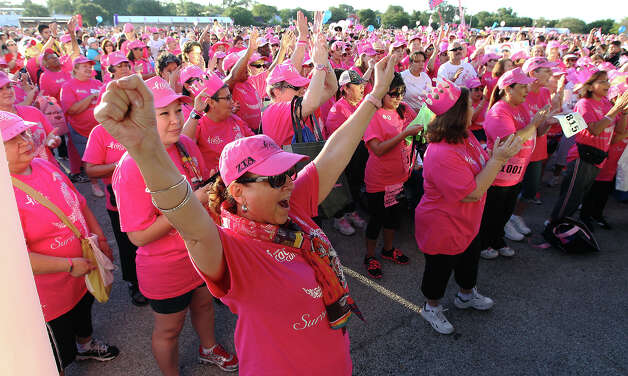 Irene Chavez (front) join other cancer survivors in cheer prior to the start of the Susan G. Komen San Antonio Race for the Cure on Saturday, May 12, 2012. Chavez said she has been free of cancer for the past five years. Kin Man Hui/Express-News. Photo: Kin Man Hui, Kin Man Hui/Express-News / San Antonio Express-News