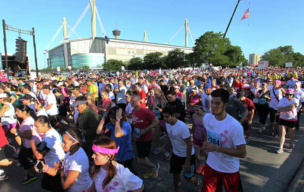 Thousands of runners fill Cherry Street near the Alamodome to start the 2012 Susan G. Komen San Antonio Race for the Cure on Saturday, May 12, 2012. Kin Man Hui/Express-News. Photo: Kin Man Hui, Kin Man Hui/Express-News / San Antonio Express-News