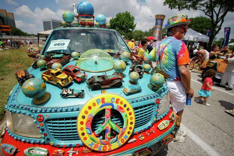 "Steve Carson stands near the art car named ""Peace Expedition"" during the 25th Anniversary Art Car Parade, Saturday, May 12, 2012, in Houston. Photo: Nick De La Torre, Houston Chronicle / © 2012  Houston Chronicle"
