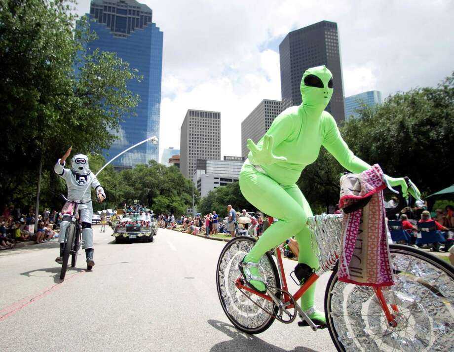 """Megan Casillas, an alien with the bike gang """"Out of this World"""", rides in the 25th Anniversary Art Car Parade, Saturday, May 12, 2012, in Houston. Photo: Nick De La Torre, Houston Chronicle / © 2012  Houston Chronicle"""