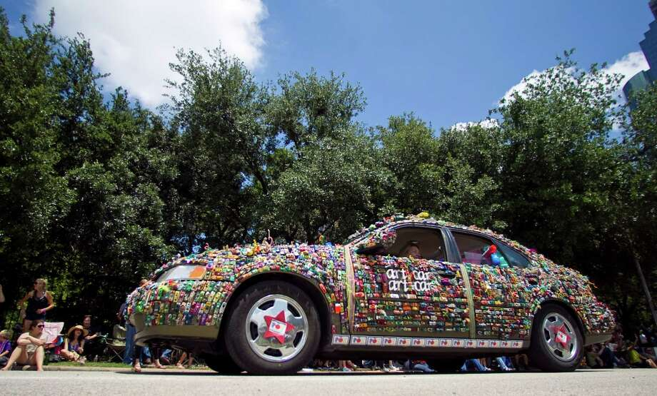 "Poe Elementary's ""Art Car Art Car"" is a car made up of a bunch of little cars during the 25th Anniversary Art Car Parade, Saturday, May 12, 2012, in Houston. Photo: Nick De La Torre, Houston Chronicle / © 2012  Houston Chronicle"