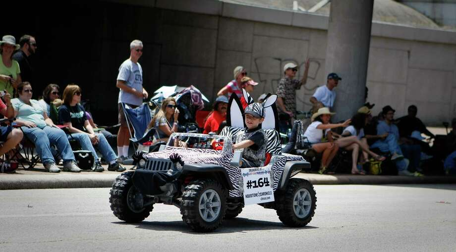 "Jon Andersen proudly rides his  ""Zebra Jeep"" as he and the rest of the Zebra convoy of cars participate in the 25th Anniversary Art Car Parade, Saturday, May 12, 2012, in Houston. Photo: Nick De La Torre, Houston Chronicle / © 2012  Houston Chronicle"