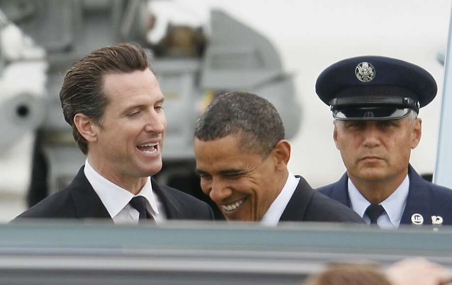 President Barack Obama laughs while being greeted by San Francisco Mayor Gavin Newsom, left, after arriving at San Francisco International Airport in San Francisco, Tuesday, May 25, 2010.  President Obama will spend Tuesday night in San Francisco to attend a pair of fundraisers with Sen. Barbara Boxer, then head to nearby Fremont, Calif., on Wednesday to tour a solar facility and make remarks on the economy. Photo: Eric Risberg, Associated Press