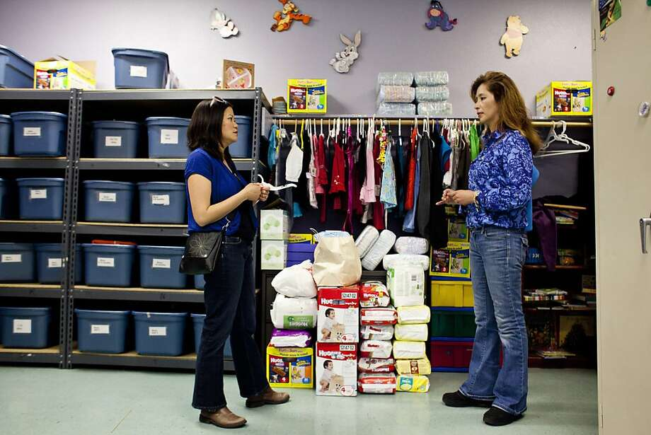 Lisa Truong, left, founder of Help a Mother Out, talks with St. Vincent DePaul Women's Center coordinator Sonia Garcia Munoz, right, after delivering a donation of about 500 diapers to St. Vincent DePaul in Oakland, Calif., May 11, 2012. The organization, Help a Mother Out, which distributes diapers to mothers in need across the Bay Area, is hoping to surpass the one million-diaper mark this Mother's Day through an annual diaper drive. Photo: Jason Henry, Special To The Chronicle