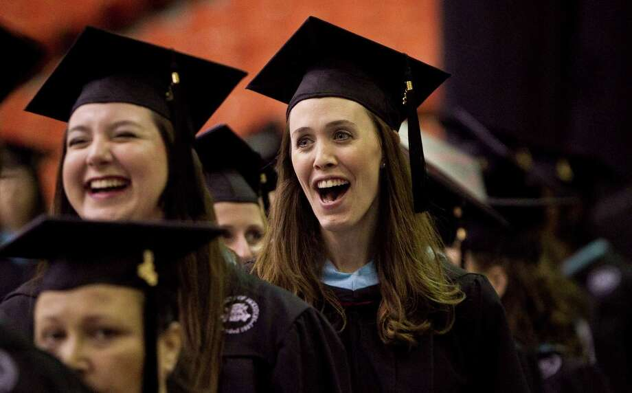 Universiy of Houston graduate Erin Galloway, center, laughs with friends as she files in for the Spring 2012 Commencement, Friday, May 11, 2012, in Houston. The colleges of Technology, Education and Hotel and Restaurant Management graduated at the 2 p.m. slot. Photo: Nick De La Torre, Houston Chronicle / © 2012  Houston Chronicle