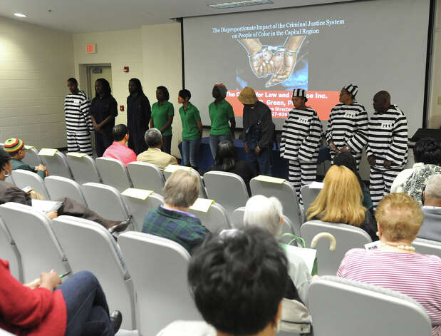 A Jim Crow skit is performed during a community forum held at the Schenectady County Community College on April 25, 2012 in Schenectady, N.Y. The Schenectady County Human Rights Commission hosted a community discussion of a report detailing major disparities in the arrest, conviction, and prison sentencing of people of color at the Schenectady County. (Lori Van Buren / Times Union) Photo: Lori Van Buren
