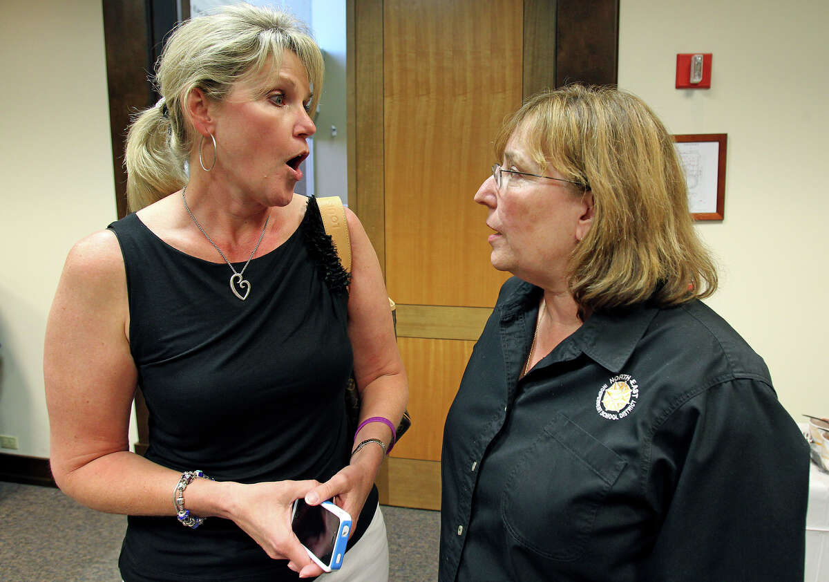 The District 5 leader in the early evening, Shannon Grona talks with District 1 hopeful Sandy Huey as candidates for trustees positions 4, 5 and 6 gather at an election results party at the board room on Tesoro Drive on May 12, 2012.