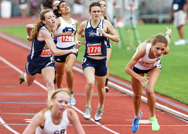 Smithson Valley's Anna Cozart (center) is caught at the finish line by Dallas Highland Park's Gabby Crank (left) for fourth place in the 4A girls' 800-meter run during the UIL state track meet at Mike A. Myers Stadium, University of Texas in Austin on May 11, 2012.  Cozart finished fifth at 2:13.42,  .04 seconds behind Crank.  MARVIN PFEIFFER/ mpfeiffer@express-news.net Photo: MARVIN PFEIFFER, Express-News / Express-News 2012